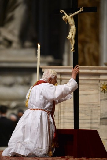 Pope Benedict XVI bows in front of the c